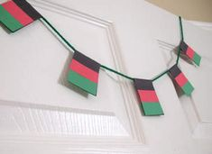 Kwanzaa Flag Garland Craft: Kwanzaa Crafts for Kids & Decorations - Kaboose.com