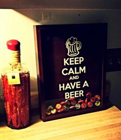 Cricut project for Derrick. I have the frame if you want it. Drink tons... save your beer top... shadow box and vinyl stickers....