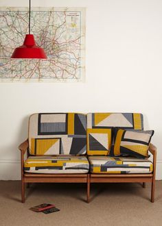 A midcentury settee upholstered in textile designer Tamasyn Gambell fabric. Gorgeous!