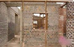 This Plastic Bottle House Turns Trash into Affordable Housing in Nigeria - In the United States alone, more than 125 million plastic bottles are discarded each day, 80 percent of which end up in a landfill. This waste could Plastic Bottle House, Recycle Plastic Bottles, Ville Durable, Architecture Organique, Brick And Wood, Bottle Wall, Energy Efficient Homes, Recycling, Earthship