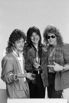 """Photo: Jack Blades, Steve Perry, and Brad Gillis pose for a photo at the 1985 """"Bammies"""", the Bay Area Music Awards, hosted every year since 1977 by BAM, a San Francisco music magazine. Blades won an award for Outstanding Bassist, and Perry won awards for Outstanding Album and Outstanding Male Vocalist. March 23, 1985 San Francisco, California, USA"""