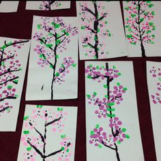 Kinder Cherry Blossom Soda bottle prints...done in 2 45 minute classes. Day 1...print flowers & paint branches. Day 2 glitter dots in center & finger print with green paint for leaves.