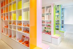 home interior store 'corazys' the apparent color scheme is orange, pink, green and blue. designed by emmanuelle moureaux, the retail space in omotesando, tokyo f Commercial Interior Design, Commercial Interiors, Architecture Design, Ceiling Shelves, Large Shelves, Store Interiors, Interior Styling, Interior Shop, Retail Space