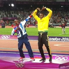 Mo Farrah (GB) with Usain Bolt (Jamaica), both won at least 2 gold medals each in track events.