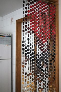 """Curtain made of Nespresso coffee capsules... Great idea & since my machine should arrive tomorrow I need to assuage my """"garbage-guilt"""" by planning a use for the used capsules."""