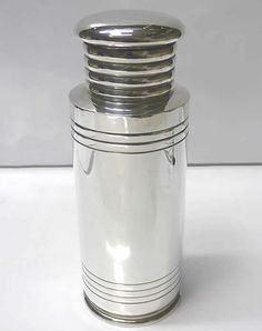 6805. Art Deco Silver Plated Cocktail Shaker by Mappin and Webb  A rare and unusual 1930s silver plated cocktail shaker with plain styling and geometric concentric lines. Height 23 cms. Diameter of base 8.5 cms. Marked underneath for Mappin and Webb