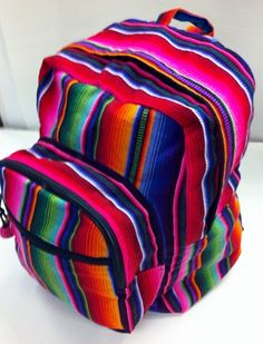 Backpack Hacienda is constructed from brightly colored cotton fabric from Guatemala. The front pocket is very roomy for your smaller essentials. The main zip pocket has plenty of room for books, noteb