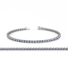 Aquamarine and Diamond (SI2-I1, G-H) 3-Prong Tennis Bracelet 2.09 ct tw in 14K White Gold. 33 Round Diamond of 0.99 ct tw & 33 Round Aquamarine of 1.10 ct tw set using 3-Prong Setting. SI2-I1-Clarity, G-H-Color Diamond & SI1-SI2-Clarity, Blue-Green-Color Aquamarine. Gemstones may have been Treated to Improve their Appearance or Durability & may Require Special Care. The Natural Properties & Composition of Mined Gemstones define the Unique Beauty of each Piece. The Image may show Slight...