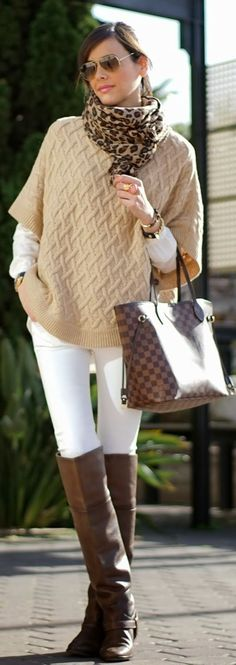 cream or beige cable sweater, white jeans, brown boots, and a scarf.