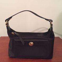 Coach Square Black Small Purse Authentic coach. Small rectangular shape. Functional zipper. Open inside, small pocket on the front. Small scuff on handle, shown in picture. Only used a few times, in great condition. All prices are negotiable! Coach Bags Mini Bags
