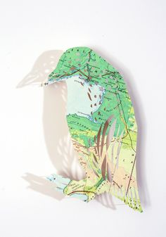 Claire Brewster; Peski Bird. Cut from atlas. Another amazing creation!