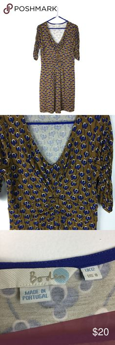 """Boden Mustard Brown & Blue Floral Print Dress Boden knit pullover dress. Mustard brown and blue pansy floral print.  Ruched sleeves. Very good condition. Viscose/elastane Size US 8 Apx: 35"""" long. 16 1/2"""" underarm to underarm. 14 1/4"""" waist flat. Boden Dresses Mini"""