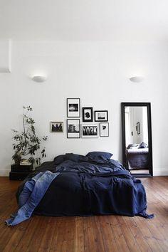 Minimalist white and navy bedroom