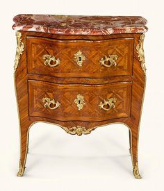 A LOUIS XV KINGWOOD AND PARQUETRY COMMODE PROBABLY BY LOUIS DELAITRE CIRCA 1750 |