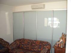 white glass sliding wardrobe
