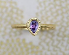 Pink Purple sapphire pear shape ring.  18k gold ring hammered. Ready to ship.