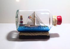 The ship in a bottle. Hand made souvenir.The ship in a bottle. Yacht model, handwork in the single copy. The bottle liters, diameter of a mouth is mm. Ship In Bottle, Great Christmas Presents, Model Ships, Cool Places To Visit, Snow Globes, Handmade, Crafts, Etsy, Yachts