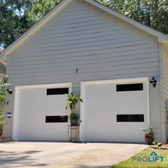 These homeowners added a modern look to their home with new garage doors with a vertical window stack. One of the best ways to affordably add style to any 'basic' garage door is with window placement. Very nice! | ProLift Garage Doors on Houzz | Photo Credit: ProLift Garage Doors Savannnah | #garagedoors #midcenturymodern #modern #windows