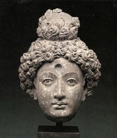 Head of Bodhisattva, ca 2nd-3rd cent. CE, Afghan, Gandhara region, terracotta with garnet inset eyes.
