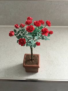 Beautiful rose bush in 1/12 scale miniature. This would look so good at the front door of a dollhouse or on a patio #ad #roses #dollhouseminiatures