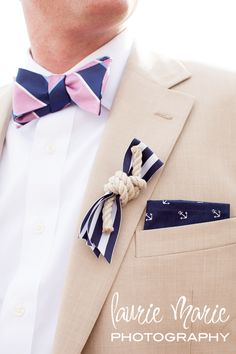 nautical boutonniere. There's a lot going on here with the pocket square and striped bow tie, but for the right groom, it works.