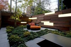 outdoor room in small private city garden, wood fence with light panels, geometric shapes, concrete patio, designed by Ground Inc. Concrete Patios, Outdoor Rooms, Outdoor Living, Outdoor Decor, Outdoor Retreat, Small Gardens, Outdoor Gardens, Modern Landscaping, Modern Backyard