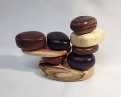 Scroll sawn handcrafted wood boxes to look like like small rocks stacked into a pile of rocks, 4 of the rocks have drawers. by SolsWoodworkingShop on Etsy