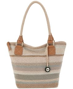 Go easy and breezy with this chic crochet carryall from The Sak. Topped with slender braided handles and a logo charm, the generous interior stashes it all.   Imported   Polypropylene   Double handles