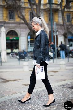 fringe jacket with skinny pants and classic pumps