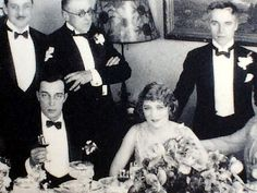 Buster Keaton, Mary Pickford, and Charlie Chaplin at a dinner party held by Joseph Schenck to welcome Rudolph Valentino into United Artists.