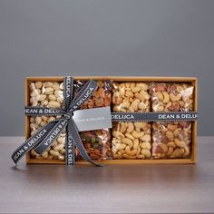 ONLY AT DEAN & DELUCA. A long-time favorite to give and receive, this sustainably, raised, reusable bamboo tray is brimming with healthful nuts and dried fruits. Fruit Packaging, Cookie Packaging, Food Packaging Design, Gift Packaging, Diy Gifts For Dad, Diy Gift Box, Diwali Gift Hampers, Ramadan Gifts, Fruit Box