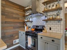 Country Kitchen with Flat panel cabinets, European Cabinets, Subway Tile…