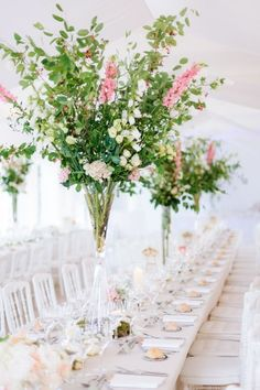 All White -- With Tall Garden-esque Centerpieces -- See More on SMP: http://www.StyleMePretty.com/destination-weddings/2014/05/21/modern-french-garden-affair-in-burgundy/ Photography: IanHolmes.net -- Event Planning & Event Design: Fête In France -- Floral Design: Sol y Flor