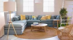 A round rug can pull a room together when you can't afford a larger, rectangular option. Living Room Sectional, Living Room Carpet, Formal Living Rooms, Sectional Sofa, Round Sofa, Round Rugs, Living Room Rug Placement, Interior Design, House Styles
