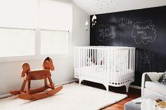 Chalkboard wall in nursery with rocking horse