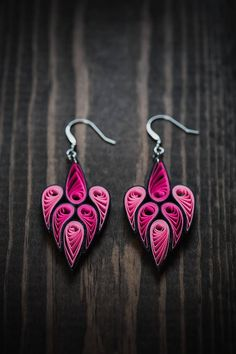 These delicately hand-crafted earrings are made from 1/8 thick Neon pink, light pink and black colored quilling strips of paper. I really like the intricate design of this earring that shows the beauty of quilling! The earrings are attached to sterling silver hooks and can also be