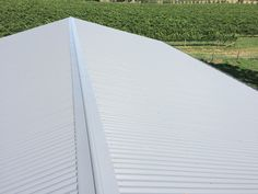 Shed Company, photo of completed roof. Owners vineyard in the back shot. Kieren Lee Plumbing & Construction 0428690696