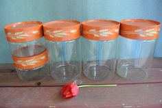 Vintage Autumn Harvest Pyrex Canister Set  - Love the storage containers; I have a ton of them.  Great for the pantry!