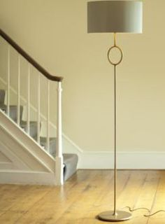 A hand forged steel standard lamp made by Jim Lawrence