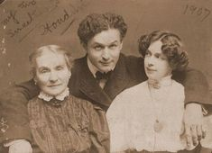 """c. 1907. """"My Two Sweethearts"""". Harry Houdini (1874-1926) with his wife Beatrice (1876-1943) and mother Cecilia Steiner Weiss, half-length portrait"""