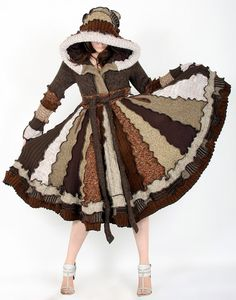 I love these coats! Not so keen on the pixie hood, but love the elegant patchwork feel. They seem so cosy.