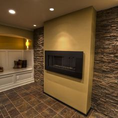 Basement fireplace at eye level. Put a built in bench on the wall opposite the TV and fireplace. Stone Accent Walls, Stone Walls, Tv Unit Interior Design, Wall Design, House Design, Basement Fireplace, Open Plan Kitchen Living Room, House Extension Design, Built In Bench