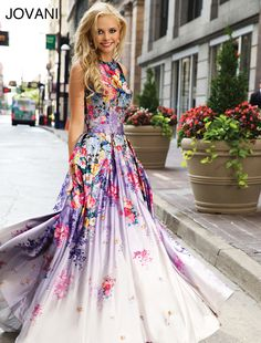 Jovani Fashions, Printed Floral Ballgown Style#: 22753   Beautiful sleeveless floor length satin floral printed Jovani ballgown features a round open back