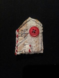 Rag House brooch £6. Made with recycled fabrics + vintage button