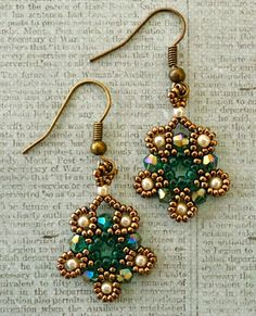 """Linda's Crafty Inspirations: Silver Moon Mini Earrings--Materials:   15/0 seed beads Miyuki """"Dark Bronze"""" (15-457D) 11/0 seed beads """"Topaz Lined Teal"""" (from Deb Roberti - no info available) 3mm bicones """"Teal AB"""" (Chinavoski) 2mm pearls """"Old Lace"""" (Aria Design Studio)--Free Pattern at http://www.cbbeads.com/silvermoonearrings.pdf"""