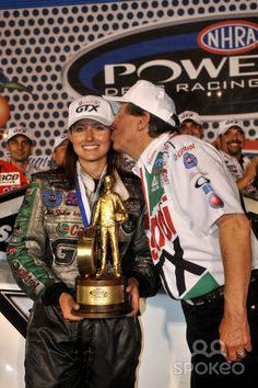 john force | NHRA funny car driver Ashley Force is kissed by her father John Force ...