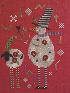 completed cross stitch Shepherds Bush Christmas snowman with sheep
