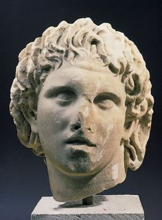 Statue of Alexander the Great by Lysippos. Lysippos (Λύσιππος) was a Greek sculptor of the 4th century BC. Together with Scopas and Praxiteles, he is considered one of the three greatest sculptors of the Classical Greek era, bringing transition into the Hellenistic period. Problems confront the study of Lysippos because of the difficulty of identifying his style amongst the copies which survive.
