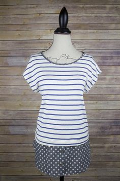 Nautical look in this stripped blue and white t-shirt with polka dot trip detail.