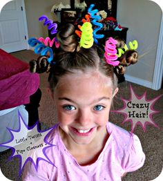 You might get a bit dizzy just staring at this hairstyle, but the double spirals look has tight hair curls and curled pipe cleaners.